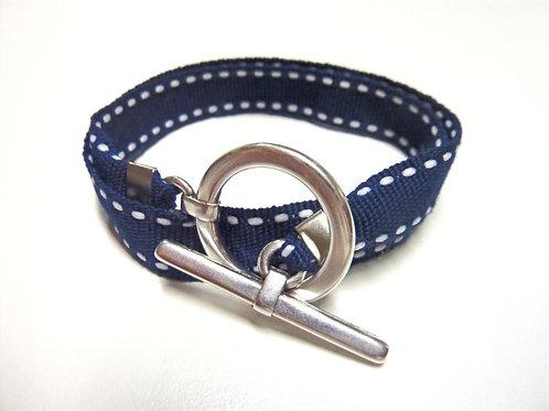 Bracelet ruban bleu marine surpiqué