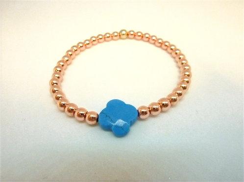 Bracelet en Hématite dorée rose trèfle en turquoise