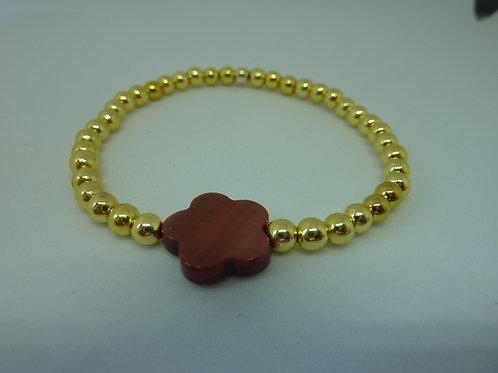 Bracelet en hématite dorée fleur en nacre