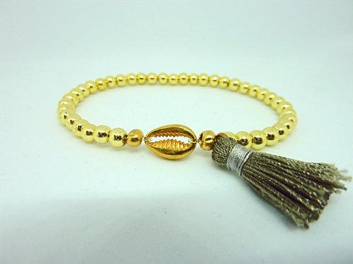 Bracelet en Hématite dorée coquillage Cauri & pompon gris