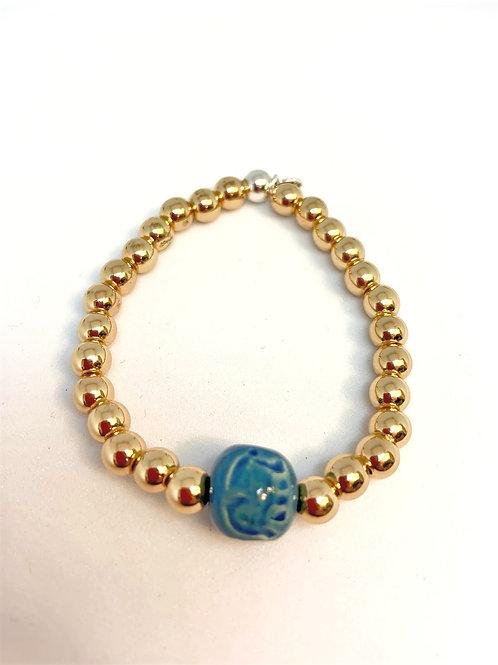 """Bracelet en Hématite plaquée or Collection Clay """"Round"""""""