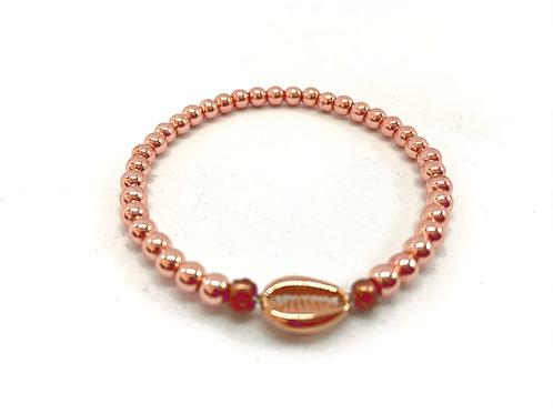 Bracelet en Hématite rose coquillage Cauri