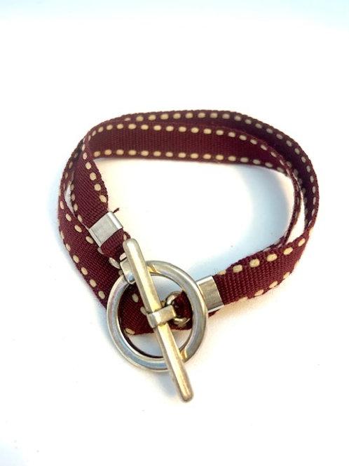 Bracelet ruban bordeau surpiqué