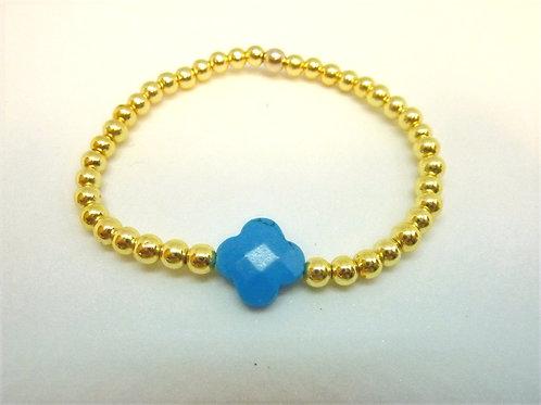 Bracelet en hématite dorée trèfle en turquoise