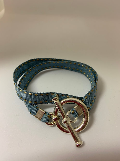 Bracelet ruban bleu surpiqûre dorée