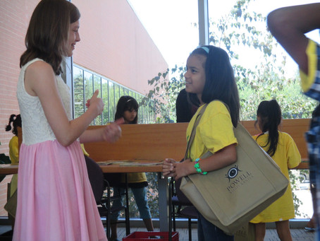 Meagan And a Fellow Book Lover Talk During the Seventh Annual Youth Summit.