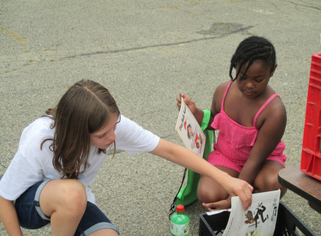Meagan Helps a Young Girl Pick Out The Right Book At The MCS T.O.U.C.H. Rally In Whitehall, Ohio.