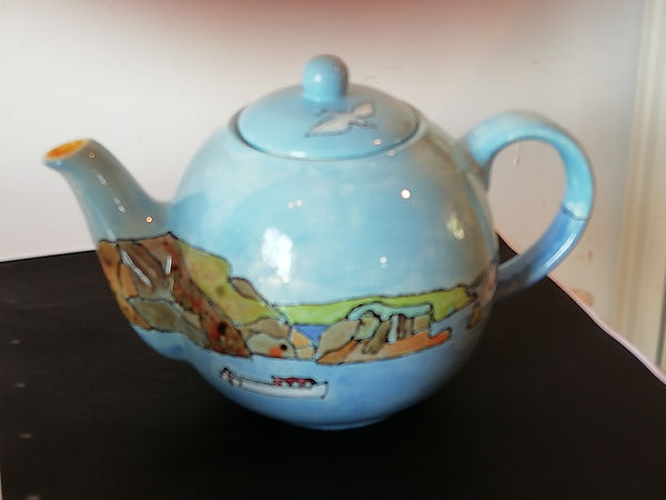 Teapot with seascape