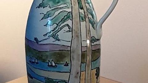 Jug with pine trees and lake