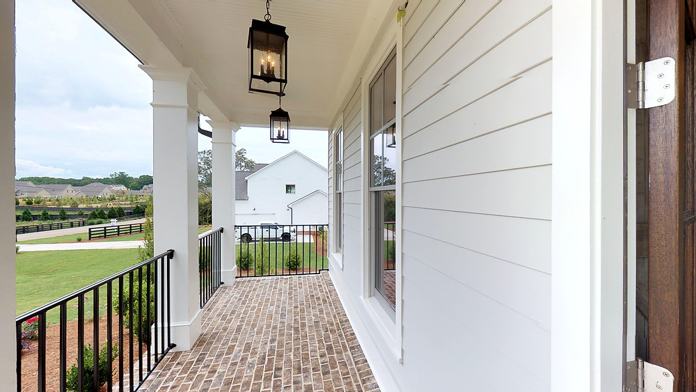 Outdoor lights hanging on a front porch of a house