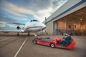 Large Business Jet towed into hangar