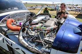 Appraiser & Mechanic Inspecting airplane
