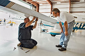 Appraiser and Mechanic Inspecting airplane