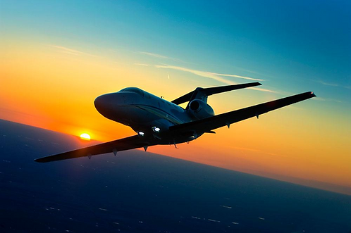 Citation Mustang banking into sunset