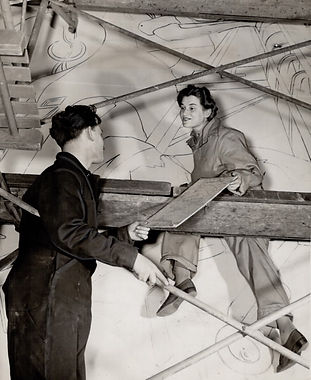 Artists Allen Wargon and Joy Bain sit on scaffolding for a war mural inside Union Station in 1944.