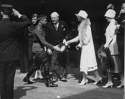 The former Prince of Wales, Prince Edward, greets Ontario's Lieutenant Governor WD Ross and his wife at Toronto's Union Station.