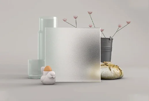 Image showing grey background with various vases and some dried flowers in one.