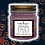 Dark purple soy candle with a label Stephen King's Study