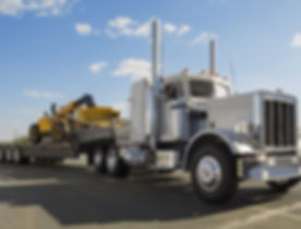 600_Heavy-Duty-Flatbed-Semi-Hauling-Construction-Equipment-000063923571_Large_525_399_c1.jpg