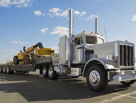 600_Heavy-Duty-Flatbed-Semi-Hauling-Construction-Equipment-000063923571_Large_525_399_c1.jpg