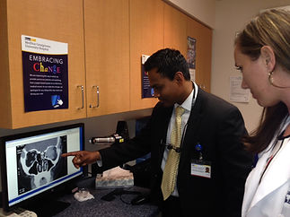 Dr T showing scan to doctors