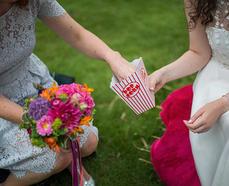 carnival wedding popcorn sharing bride r