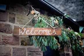 rustic welcome sign natalie tom.jpg