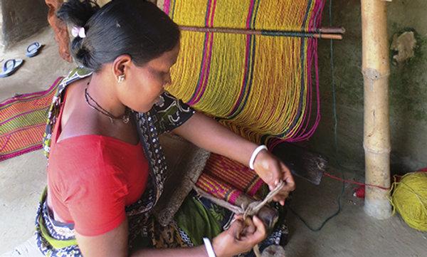 A woman using a loom.