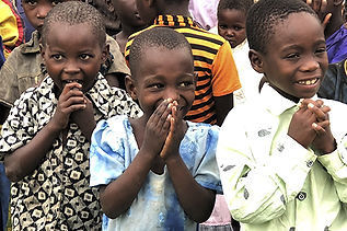 Children smiling at a CDC in Malawi.