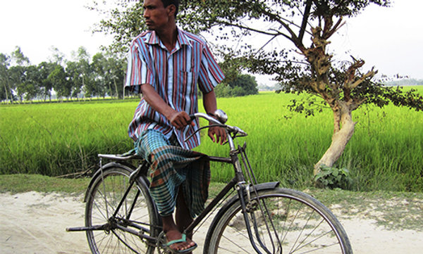 A pastor riding a bicycle.