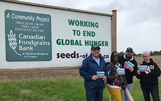 Supporters standing in front of Seeds of Life Markdale program sign.