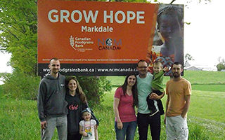 Supporters standing in front of Grow Hope Markdale program sign.