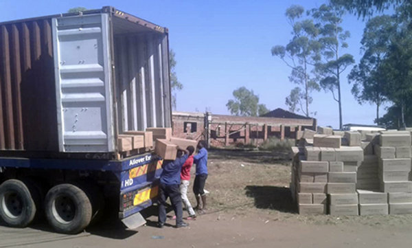 Container shipment of relief goods for disaster-stricken area.