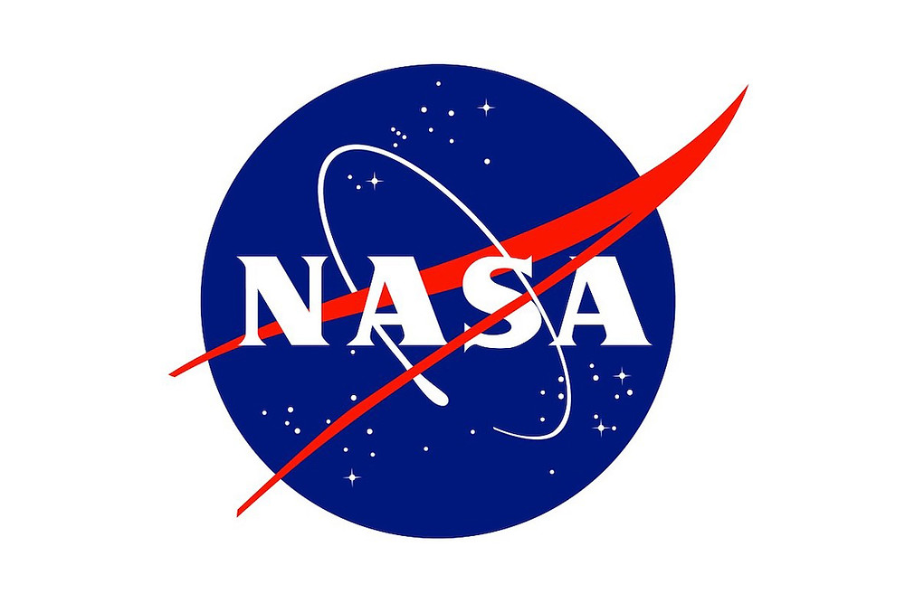 "NASA logo known as the ""meatball"".  Description from the NASA website says In the ""meatball"" design, the sphere represents a planet, the stars represent space, the red chevron is a wing representing aeronautics (the latest design in hypersonic wings at the time the logo was developed), and then there is an orbiting spacecraft going around the wing."