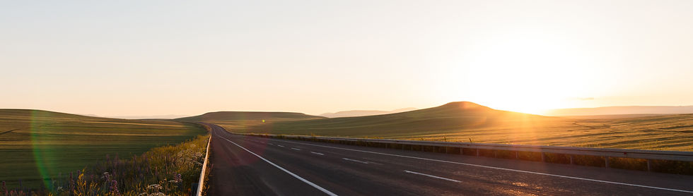 Empty road and beautiful rolling hills