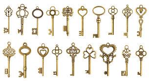 Set of vintage golden skeleton keys isol