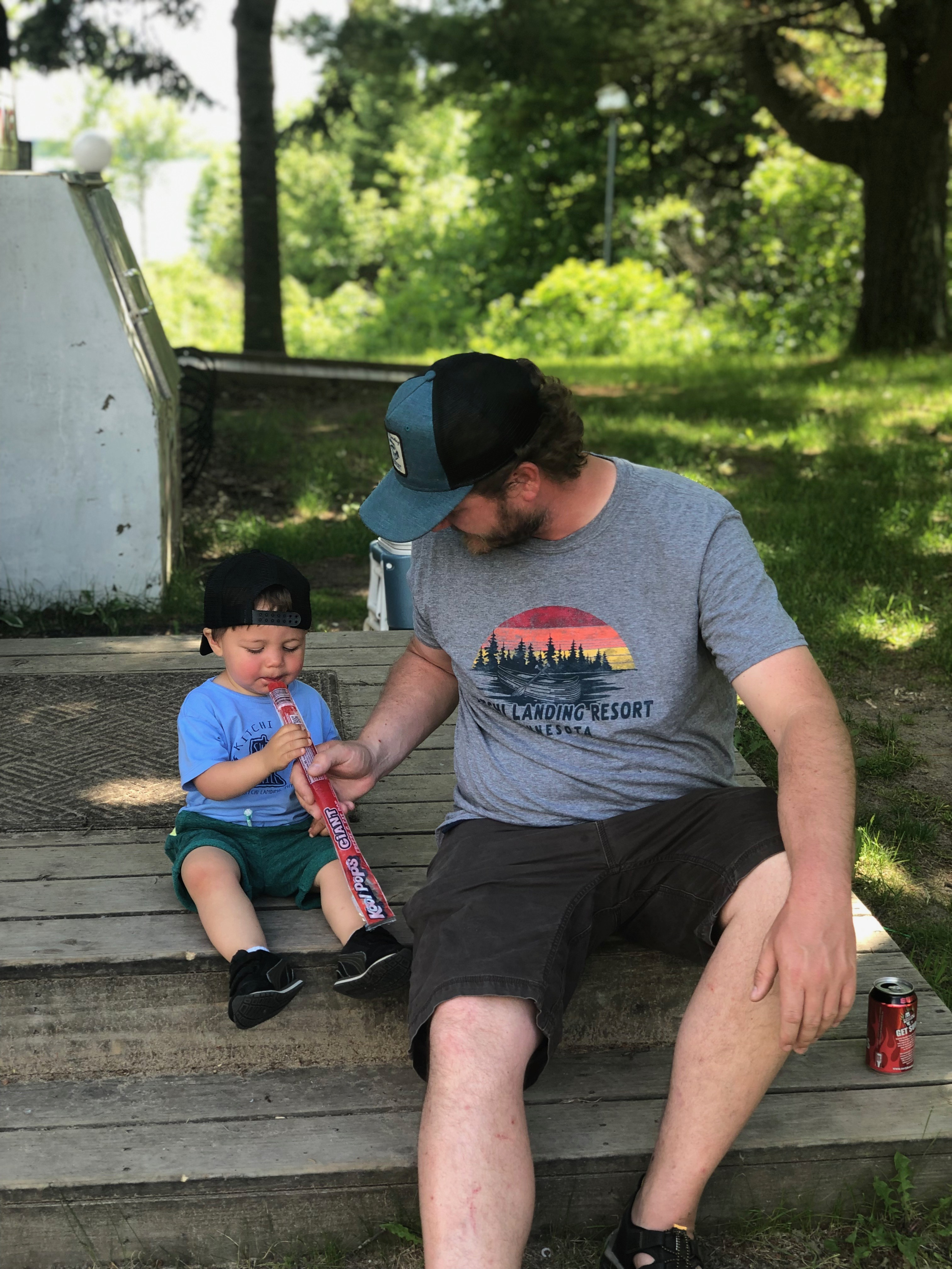 Father and son eating frozen treat