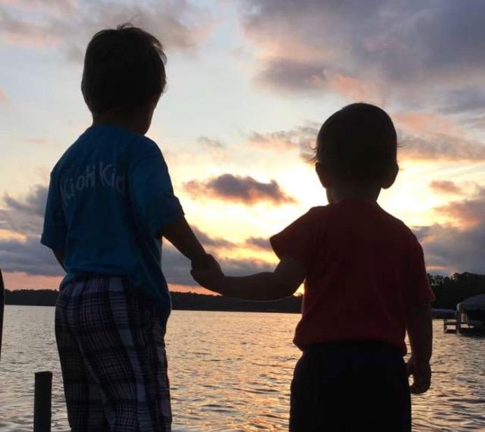 Two children enjoying the sunset