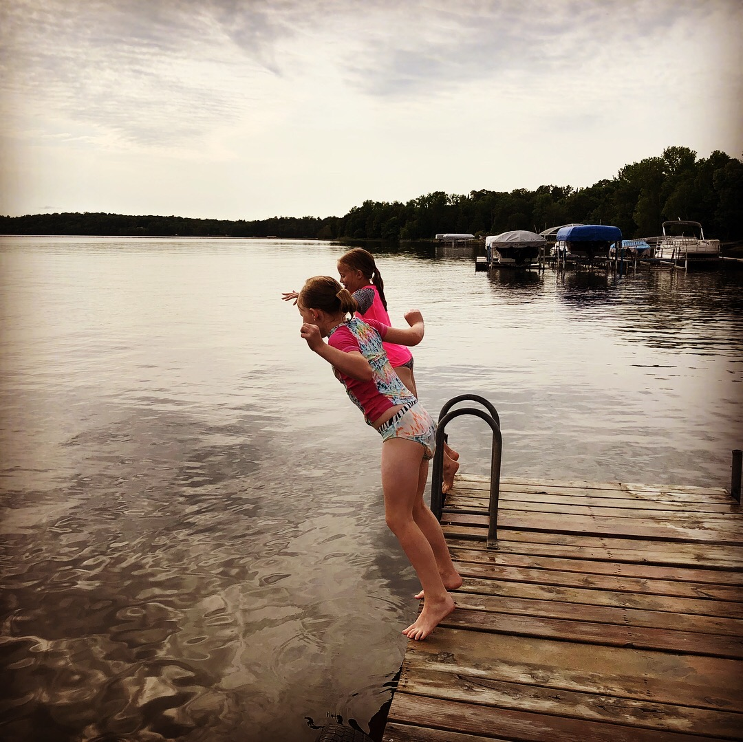 Kids jumping off the dock