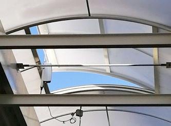 Motorized skylight window