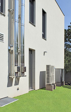Side of the house - heat pumps and chimneys