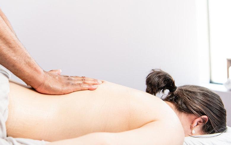 massage therapist performs massage