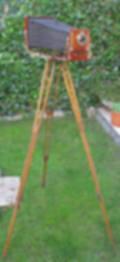 wood and brass stand victorian edwardian english plate camera on tripod baush and lomb lens on garden