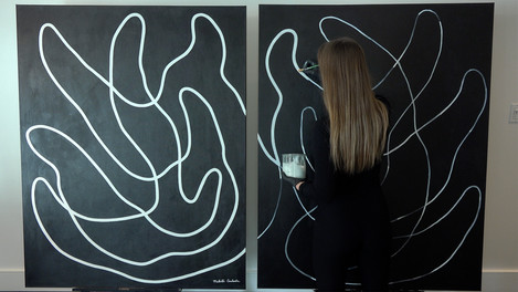 Nikita Coulombe painting Buddha's Hands