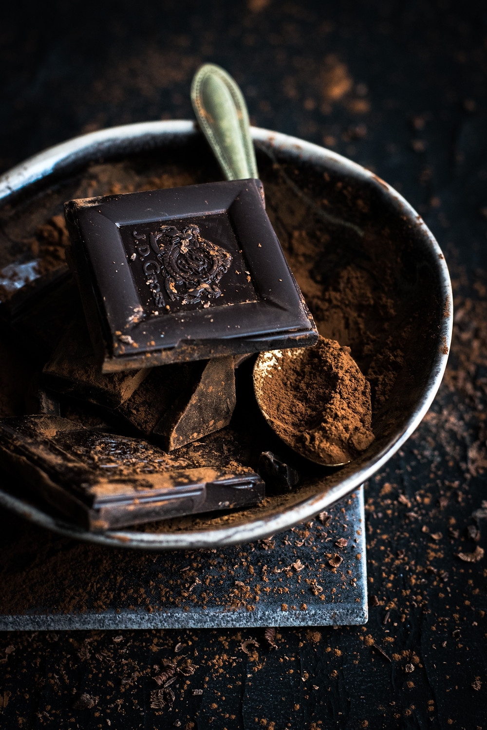 dark-rich-brown-chocolate-pieces-and-cocoa-powder-with-spoon-on-dish