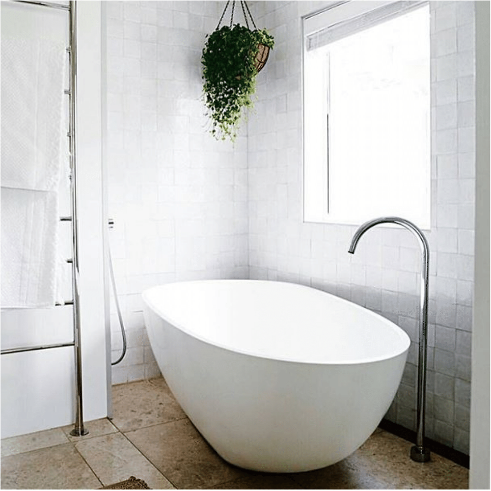 luxury-bathroom-wth-white-bath-and-hanging-plant