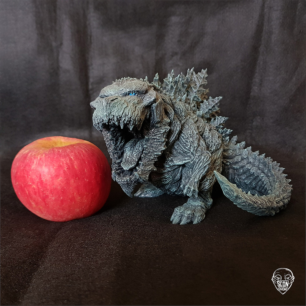 Size comparison of Defo-Real Godzilla Earth 2017 with an apple.
