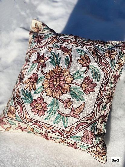 Hand-embroidered silk Suzani pillows from Uzbekistan