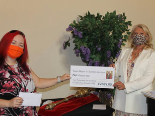 Former Town Mayor makes donation to local charities