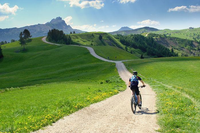 Biker riding scenic path in beautiful su